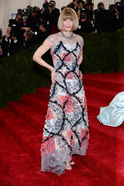 Anna Wintour looked every bit the queen of fashion in a multicolored appliqued gown by Chanel Couture during the Met Gala.