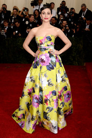 Emmy Rossum went for a goddess-of-spring look in a floral strapless gown by Carolina Herrera during the Met Gala.