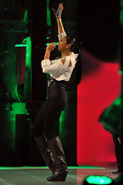 Alesha Dixon performed at the Charles Vogele Fashion Days wearing a pair of knee-high black wedge boots.