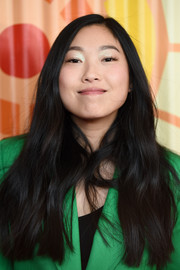 Awkwafina attended the Charlize Theron Africa Outreach Project fundraising event wearing a loose side-parted hairstyle with just the slightest wave.