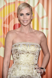 Charlize Theron accessorized with a stylish leather-band quartz watch.