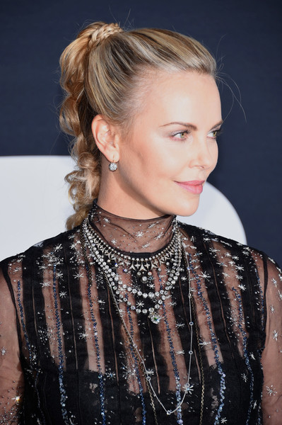 Charlize Theron Long Braided Hairstyle [the fate of the furious,hair,hairstyle,eyebrow,blond,long hair,beauty,fashion,brown hair,lip,bun,charlize theron,new york city,radio city music hall,new york premiere]