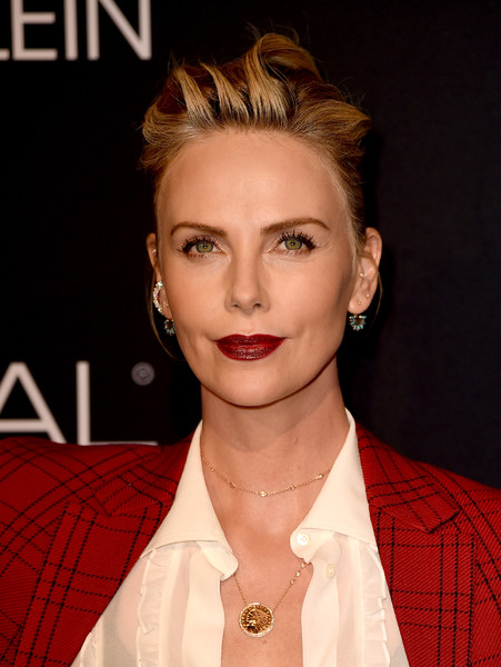 Charlize Theron Red Lipstick [elle women in hollywood celebration - arrivals,charlize theron,hair,face,hairstyle,eyebrow,lip,chin,beauty,blond,forehead,eyelash,elle women in hollywood celebration,four seasons hotel,california,los angeles,beverly hills]