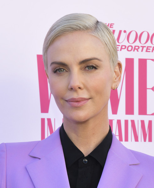 Charlize Theron Short Side Part [the hollywood reporter,hair,face,eyebrow,hairstyle,blond,forehead,chin,skin,pink,white-collar worker,arrivals,charlize theron,hollywood,california,hollywood reporter,milk studios,annual women in entertainment breakfast gala]