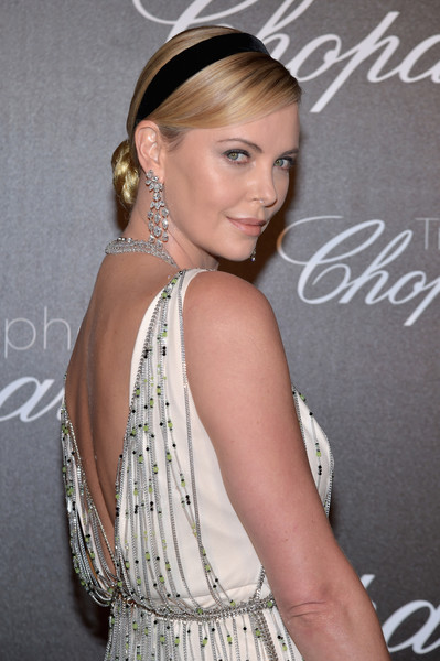 Charlize Theron Braided Bun [chopard trophy photocall,hair,beauty,fashion model,hair accessory,human hair color,hairstyle,jewellery,blond,shoulder,headpiece,charlize theron,photocall,chopard trophy,hotel martinez,cannes film festival]