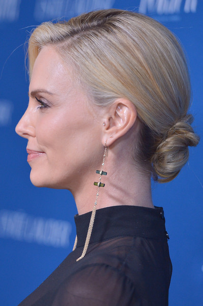 Charlize Theron Twisted Bun [hair,face,hairstyle,chin,blond,ear,beauty,neck,chignon,cheek,charlize theron,ebell,porter incredible women gala,los angeles,california]
