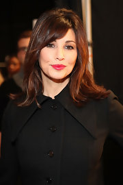 Gina Gershon brought a bright pop of color to her look with a swipe of rich red lipstick at the Charlotte Ronson fashion show.