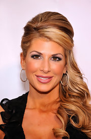 Alexis Bellino added a little gleam to her voluminous updo. Pink lip gloss was the perfect finishing touch to her look.