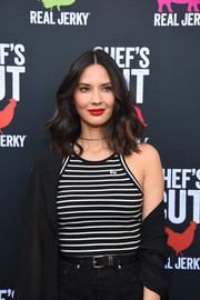 Olivia Munn looked summery in a black-and-white striped tank top at the Chef's Cut Real Jerky event.