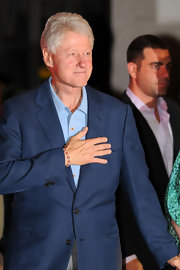 Bill Clinton wore a beaded pink and white woven bracelet with a casual blue blazer prior to daughter Chelsea Clinton's wedding.