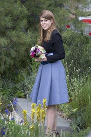 Princess Beatrice cut a girly silhouette in this flared blue skirt during the Chelsea Flower Show.