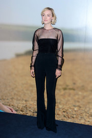 Saoirse Ronan looked sophisticated in a black Cushnie et Ochs blouse with a sheer yoke and sleeves at the special screening of 'On Chesil Beach.'