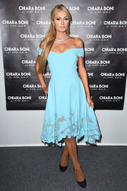 Paris Hilton was prom-glam in a sky-blue off-the-shoulder dress by La Petite Robe di Chiara Boni during the label's fashion show.