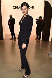 Isabeli Fontana showed off her supermodel figure in a form-fitting black jumpsuit at the Chiara Boni La Petite Robe fashion show.