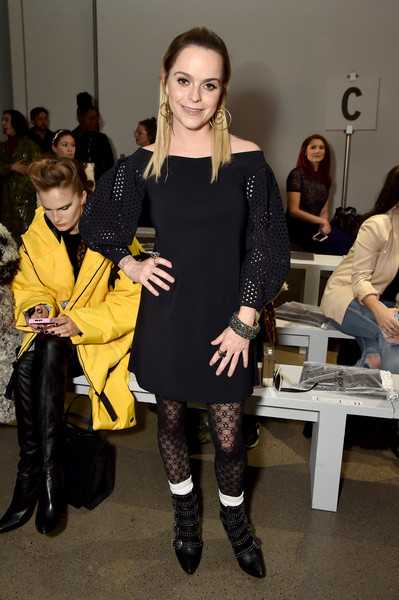 Taryn Manning donned a black off-the-shoulder dress with perforated sleeves for the Chiara Boni La Petite Robe fashion show.