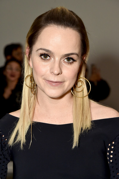Taryn Manning attended the Chiara Boni La Petite Robe fashion show wearing this half-up straight hairstyle.