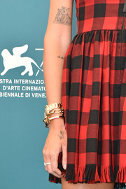 Near her angel tattoo, Chiara Ferragni has a couple of lettering tattoos that say, 'Baby girl' and 'Life is made of small moments like this.'