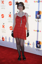 Sarah Drew turned up the fun factor in a red flapper dress at the Children Affected By AIDS Foundation Halloween Event.