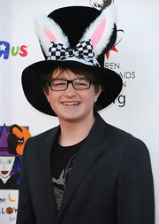 Angus T. Jones attended the Dream Halloween event wearing a huge black hat adorned with a checkered bow and rabbit ears.
