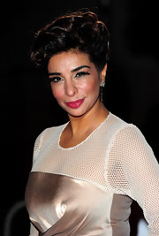 Shobna swapped her usual long wavy style for this curled retro updo at the 2010 Children's Champions Awards.
