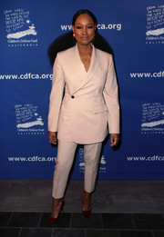 Garcelle Beauvais styled her suit with purple pumps.