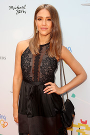 Jessica Alba arrived for the Empathy Rocks event carrying a classic quilted leather bag by Chanel.