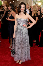 Rachel Weisz opted for a classic silver strapless dress by Chanel Couture for her Met Gala red carpet look.