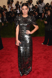 Adele Exarchopoulos went for high shine in a fully sequined Louis Vuitton gown during the Met Gala.