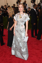 Annabelle Wallis looked like royalty in an intricately detailed ice-blue Dolce & Gabbana gown during the Met Gala.