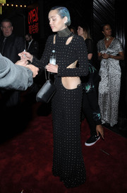 Miley Cyrus left Rihanna's Met Gala after-party carrying an elegant black satin wristlet.