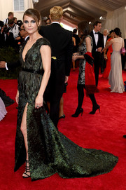 Keri Russell was all about edgy glamour at the Met Gala in a deep-V, high-slit green Altuzarra gown with a feathered bodice.