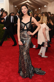 Liu Wen shimmered in a gunmetal-gray lace cutout gown by Michael Kors during the Met Gala.