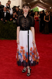 Lily Collins hovered between sweet and sultry in a sheer black button-down blouse by Chanel Couture during the Met Gala.