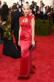 Rita Ora worked a slinky red cheongsam by Tom Ford during the Met Gala.