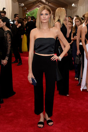 Constance Jablonski kept up the casual vibe with a pair of cropped black slacks, also by Theory.