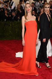 Jaime King went for minimalist elegance in a red Boss strapless gown during the Met Gala.