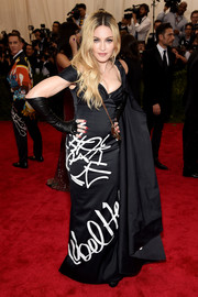 Madonna looked quite the fashion rebel in her Moschino graffiti-print gown during the Met Gala.