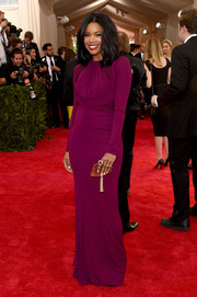 Gabrielle Union kept it subdued yet elegant in a long-sleeve purple column dress by Zac Posen at the Met Gala.