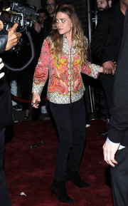 Even after the Met Gala, Ashley Olsen was still on theme in a dragon and bird-print sequined jacket.