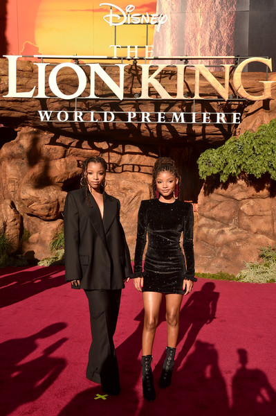 Chloe Bailey Pantsuit [the lion king,red carpet,carpet,fashion,movie,flooring,premiere,album cover,adaptation,event,formal wear,halle bailey,chloe bailey,dolby theatre,california,hollywood,world premiere of disney,l,world premiere]