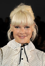 Micky Green accented her french twist with face framing bangs.