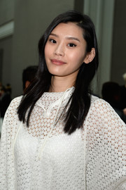 Ming Xi kept it simple with this straight side-parted style at the Chloe fashion show.