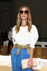 Rosie Huntington-Whiteley styled her white top and blue pants with a soft beige leather belt for the Chloe fashion show.