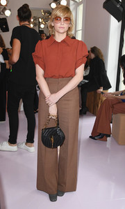 Haley Bennett paired her shirt with tan wide-leg pants.