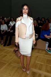Miroslava Duma styled a white turtleneck dress with an ultra-chic tricolor leather jacket for the Chloe fashion show.