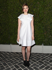 Bella Heathcote sported a girly vibe in a ruffled white cocktail dress during the Chloe LA fashion show and dinner.