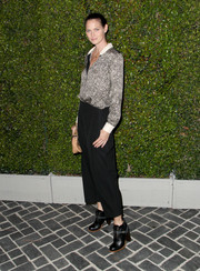 Mini Anden polished off her androgynous-chic ensemble with a pair of black lace-up booties.
