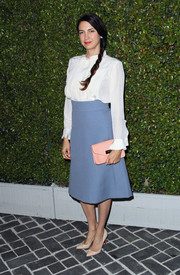 Shiva Rose's blue A-line skirt infused a '70s feel into her look.