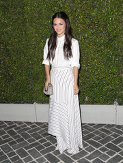 Rachel Bilson styled her top with a chic striped Chloe maxi skirt featuring a handkerchief hem.
