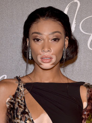 Winnie Harlow attended the Chopard dinner in honor of Rihanna wearing her hair in a demure chignon.